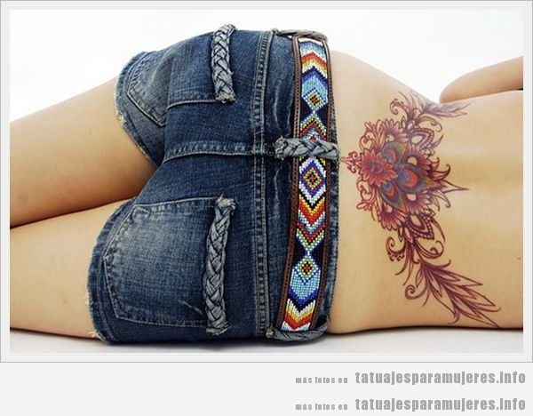 Tatuaje tribal para chica en la zona lumbar